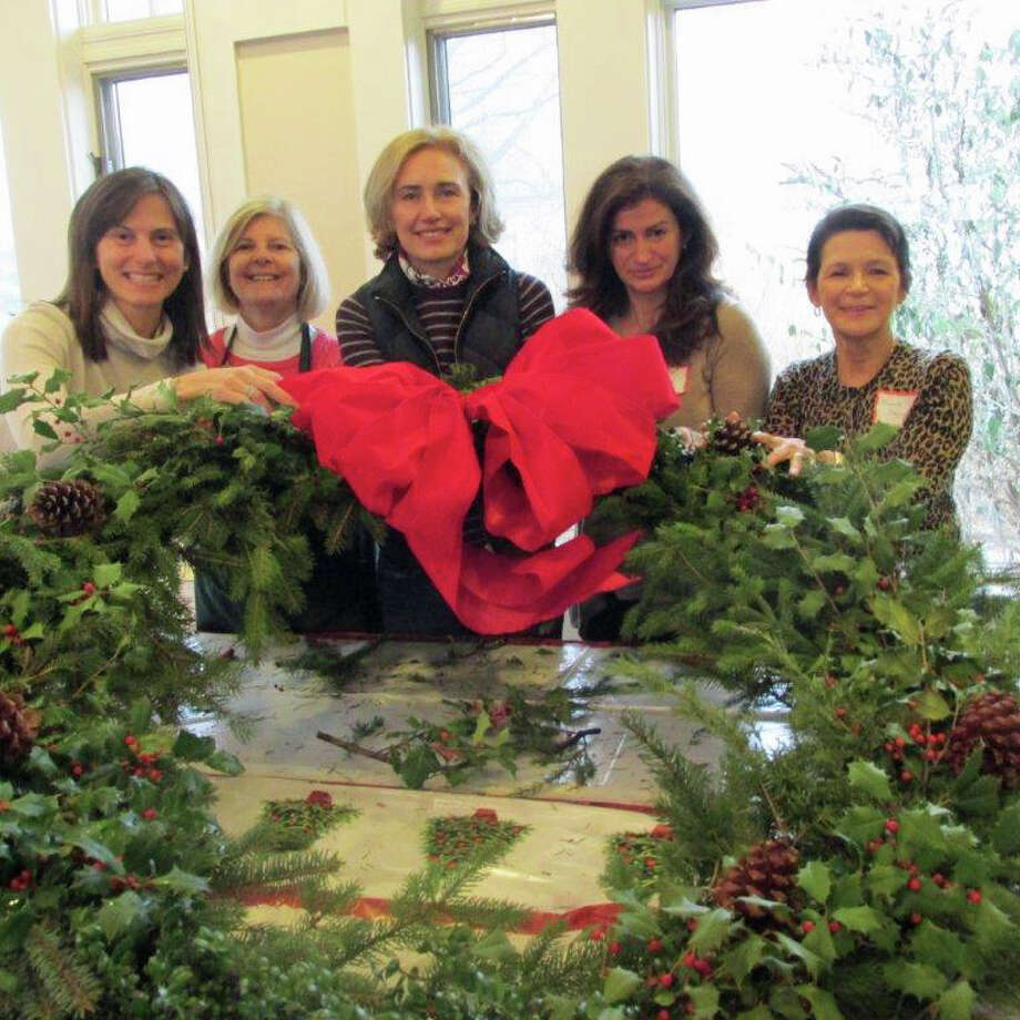 Santaís helpers from the New Canaan Beautification League and New Canaan Garden Club prepare Christmas wreaths to decorate town buildings. Members of both organizations meet yearly to decorate large wreathes for New Canaan High School, the Outback, town hall and the police station. From left, Effie Trahanas, Catharine Sturgess, Loretta Lewis, Virginia Schwartz and Michelle Sheppard. Photo: Contributed Photo / New Canaan News