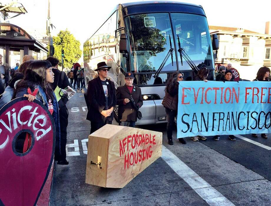 Anti-gentrification protesters temporarily block a shuttle bus full of tech workers on Dec. 20, 2013, in San Francisco's Mission District. Photo: Kurtis Alexander, The Chronicle