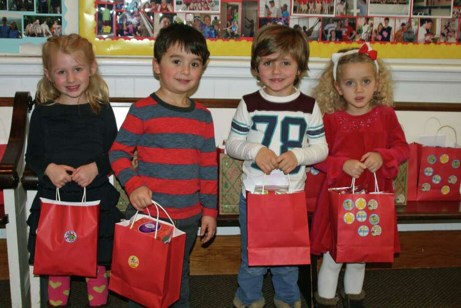 The Congregational Church of New Canaan and Toddlertime Nursery School joined together to write cards and fill bags of holiday treats for elderly residents. This is the second in a series of gatherings between the Congregational Church and Toddlertime to discuss values such as courage, compassion and forgiveness. Toddlertime is located on the ground floor of the Congregational Church and provides preschool programs for children ages 2 to 6. From left, Molly Wolter, Spencer Schaefer, Grey Wildman and Brooke Bisesi. Photo: Contributed Photo / New Canaan News
