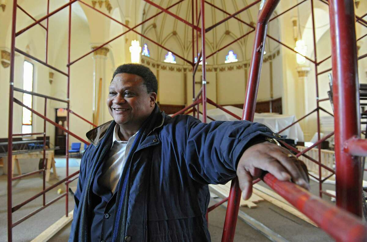 Pastor Wendell Williamson stands among construction of the Good Ground Family Church, formerly St. Agnes Church, on Wednesday, Dec. 18, 2013, in Cohoes N.Y. (Lori Van Buren / Times Union)