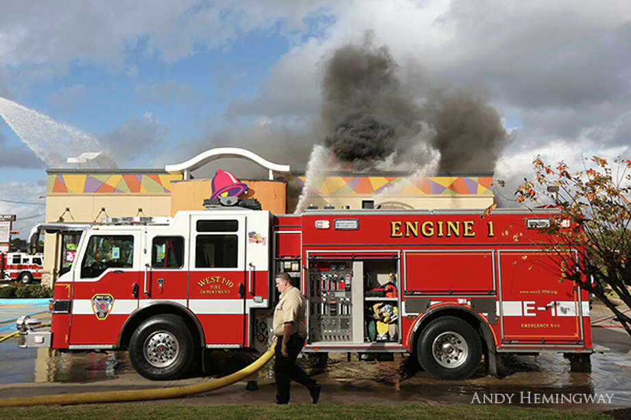Firefighters battle a blaze at a Katy Taco Bell, Dec. 19, 2013. (Andy Hemingway photos)