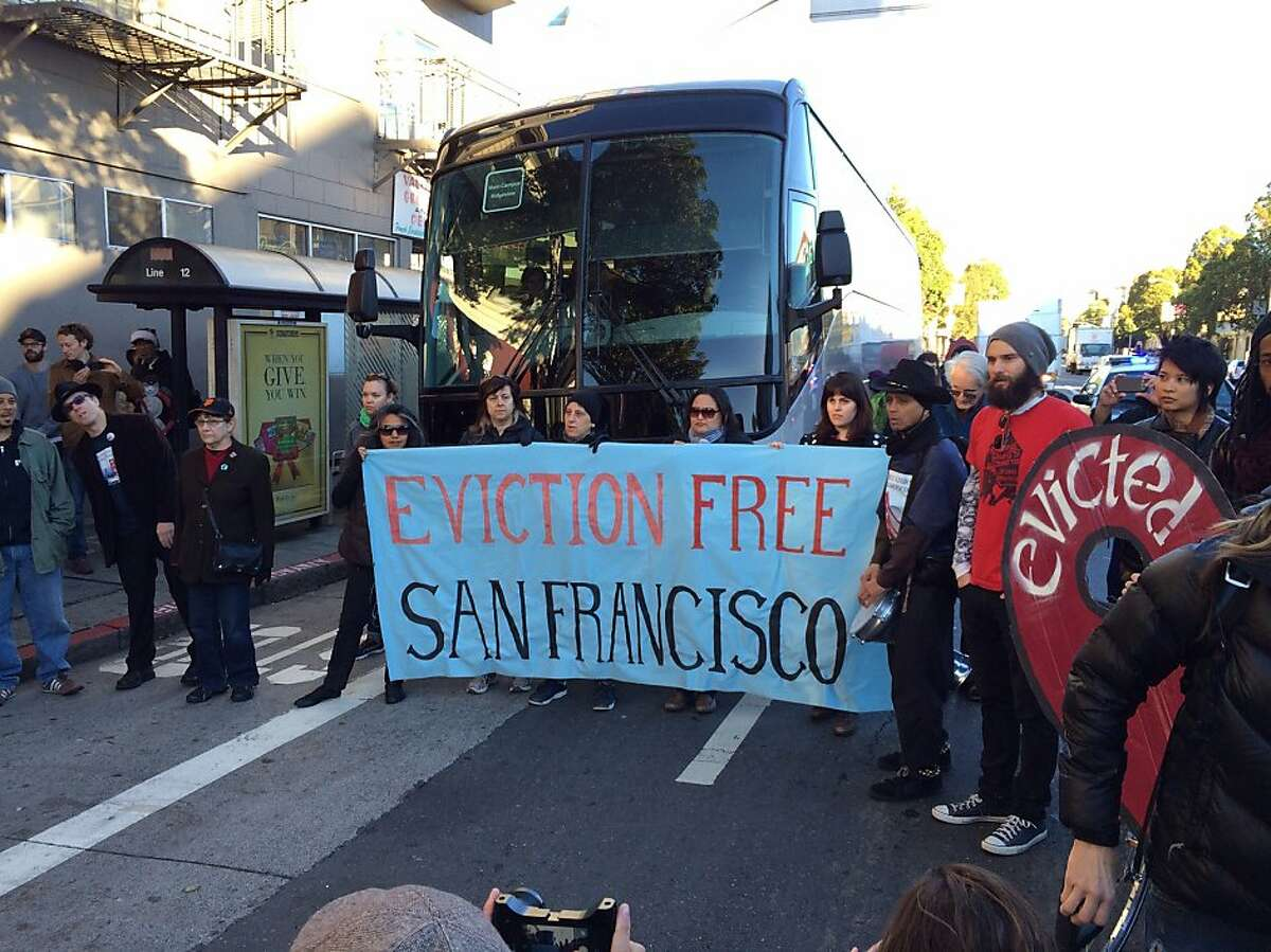 Anti-gentrification protesters temporarily block a shuttle bus full of tech workers on Dec. 20, 2013, in San Francisco's Mission District.