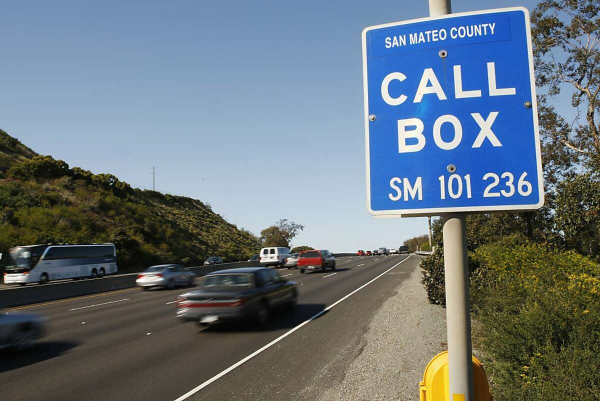 Cars whiz past a call box alongside freeway 101 in San Francisco Calif, on Friday, April 29, 2011.