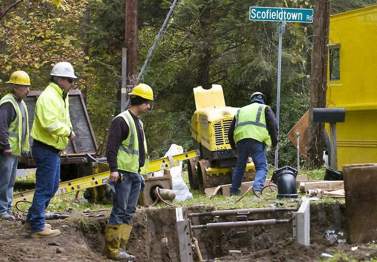 Contractors for the city of Stamford installing water lines to address contaminated wells on at the corner of Scofieldtown Road and Hannahs Road on Thursday, October 15, 2009 in Stamford, Conn.