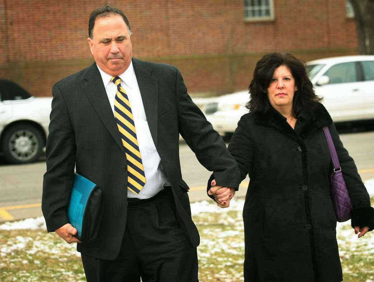 Former Supt. Harvey Polansky leaves Milford Superior Court on Tuesday, February 2, 2010, holding hands with his wife, Harriet Polansky after his arraignment on charges of alleged inappropriate contact with two female principals.