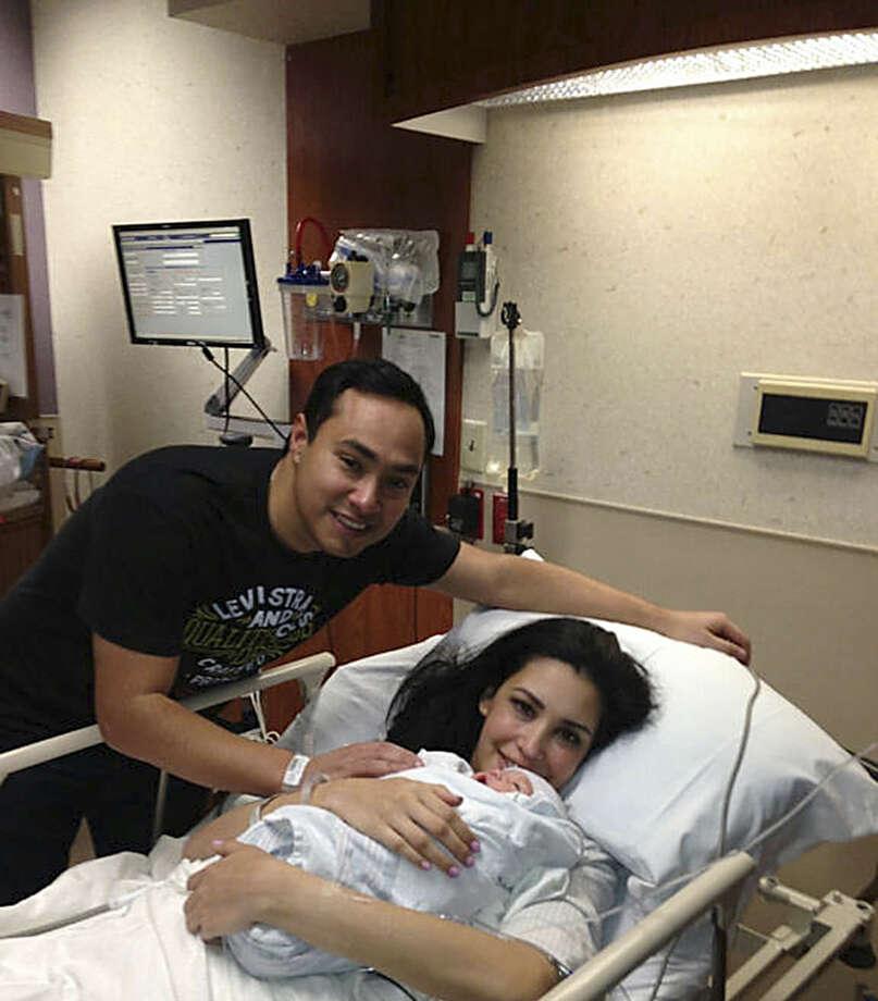 U.S. Rep. Joaquin Castro stands by his wife Anna and newborn child. Photo: Courtesy Photo / Congressman Joaquin Castro