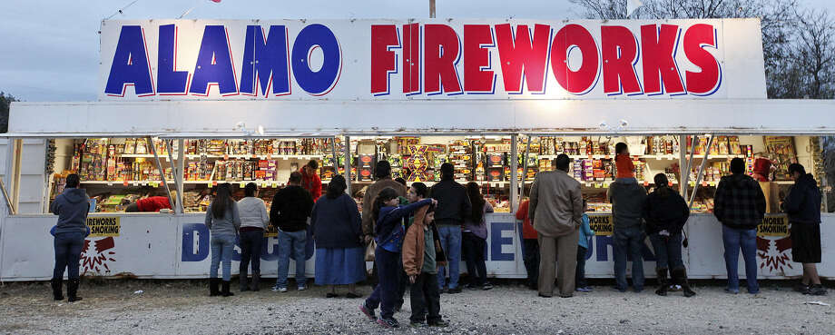 Customers buy fireworks at a stand on Pue Road. Photo: San Antonio Express-News / © 2012 San Antonio Express-News