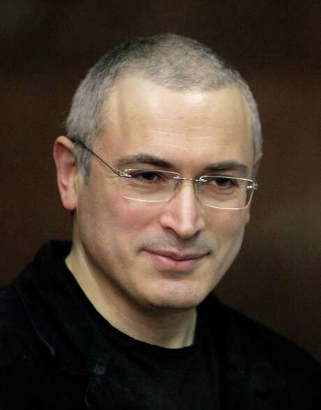 FILE In this Thursday, Dec. 30, 2010 file photo Mikhail Khodorkovsky stands behind glass at a court room in Moscow,  Russia. Russian President Vladimir Putin said Thursday Dec. 19, 2013 after his annual news conference that Khodorkovsky will pardon jailed tycoon Mikhail Khodorkovsky. (AP Photo/Alexander Zemlianichenko Jr) Photo: Alexander Zemlianichenko Jr, STR / AP