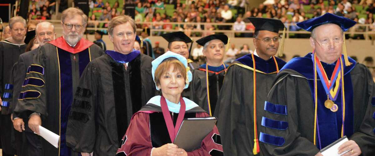 Texas A&M University-San Antonio President Maria Hernandez Ferrier, center, is flanked by state and university officials during a procession at the university's fall commencement ceremony last week. The 500-plus graduates at the ceremony made up the university's largest fall class ever.