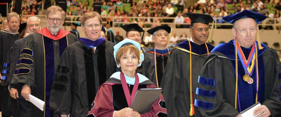 Texas A&M University-San Antonio President Maria Hernandez Ferrier, center, is flanked by state and university officials during a procession at the university's fall commencement ceremony last week. The 500-plus graduates at the ceremony made up the university's largest fall class ever. Photo: Courtesy Photo