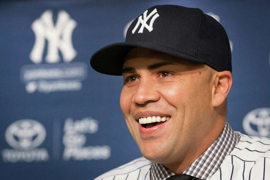 Carlos Beltran smiles during a news conference at Yankees Stadium, Friday, Dec. 20, 2013, in New York. The former St. Louis Cardinals outfielder signed with the New York Yankees on a $45 million, three-year contract. (AP Photo/John Minchillo) ORG XMIT: NYJM114 Photo: John Minchillo / FR170537 AP