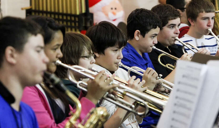 The Somerset Junior High Band performs at the San Antonio International Airport Dec. 13. More than 50 groups performed holiday music for travelers and  staff. Photo: Marvin Pfeiffer / Southside Reporter / Prime Time Newspapers 2013