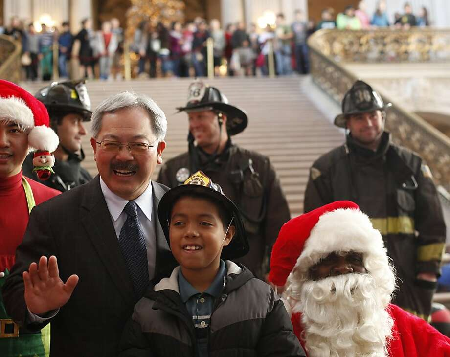 Mayor Ed Lee and Rodrigo Espinosa, 9, were at City Hall in 2012 with members of the S.F. Firefighters Toy Program that even then needed to find a new home. Photo: Mike Kepka, The Chronicle