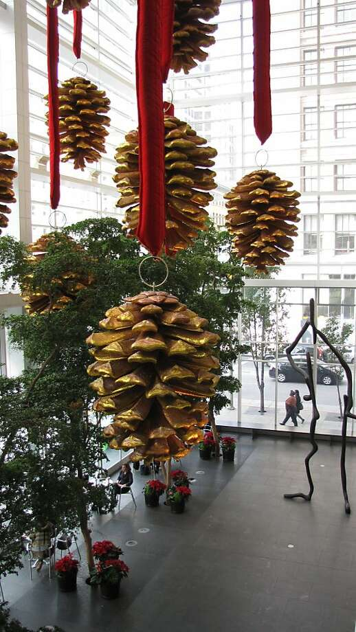 "Financial District towers with large holiday decorations include 101 California St. with its tree ornaments, 345 California St. with a huge wreath and 101 2nd St. with huge pine cones hanging in its public ""art pavilion."" Photo: John King"