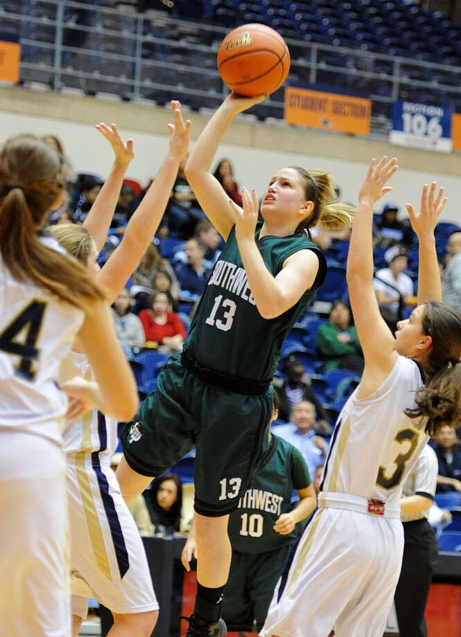 Southwest's Tiffani Rodriguezshoots during a 2012  game with O'Connor. Photo: San Antonio Express-News / San Antonio Express-News