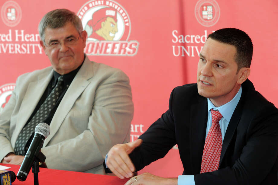 New Sacred Heart University men's basketball coach Anthony Latina speaks at a press confernece in the McMahon Center on campus in Fairfield, Conn., May 30th, 2013. Latina is seen here with former coach Dave Bike. Photo: Ned Gerard / Connecticut Post