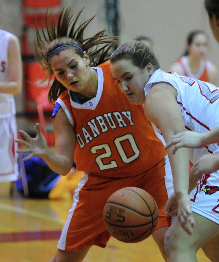 At left, Allie Smith (# 20) of Danbury goes for a loose ball along with Emily Anderson (# 20) of Greenwich during the girls high school basketball game between Greenwich High School and Danbury High School at Greenwich, Friday night, Dec. 20, 2013. Photo: Bob Luckey / Greenwich Time