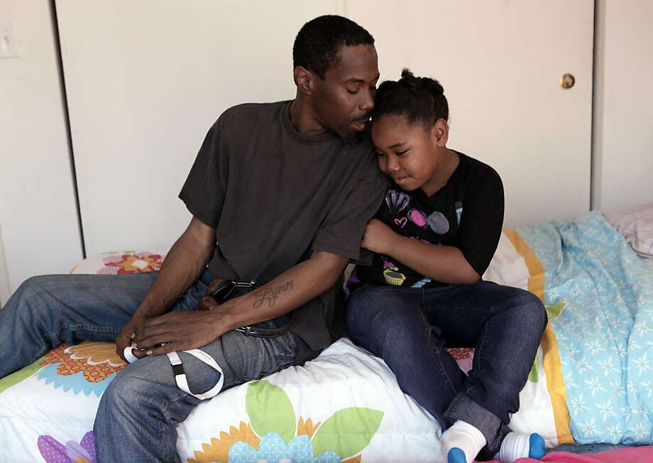 Anthony Hodges and 6-year-old Akacia were able to move into an apartment of their own and buy bedroom furniture. Photo: Liz Hafalia, The Chronicle