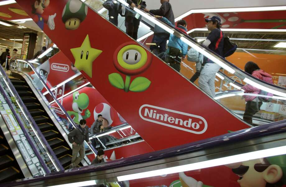 This holiday season, Nintendo faces a critical test with its Wii U video game console, which is pitted against Sony's PlayStation 4 and Microsoft's Xbox One. Photo: Shizuo Kambayashi, STF / AP