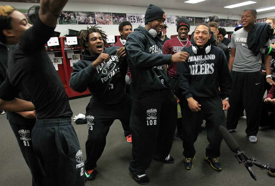 Pearland Oilers Varsity Football Team dance for a bit as they wait for a team meeting before leaving to Dallas for Saturday's State game on Friday, Dec. 20, 2013, in Pearland. Photo: Mayra Beltran, Houston Chronicle / © 2013 Houston Chronicle