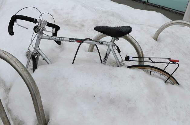 A bicycle tied to a bike rack is buried in snow outside of EMPAC at RPI on Friday, Dec. 20, 2013 in Troy, N.Y. (Lori Van Buren / Times Union) Photo: Lori Van Buren