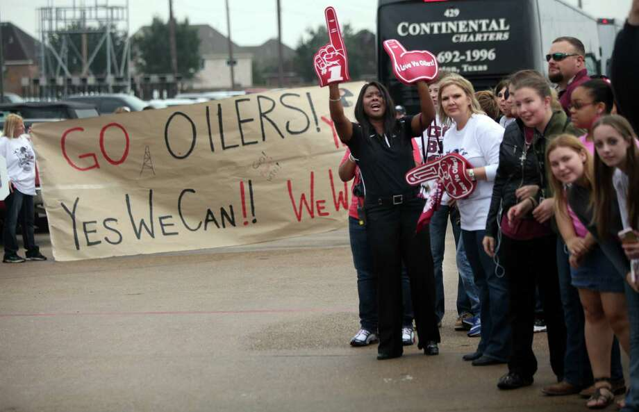 Family, students, and faculty send off the Pearland Oilers Varsity Football Team on their day to play State in Dallas on Friday, Dec. 20, 2013, in Pearland. Photo: Mayra Beltran, Houston Chronicle / © 2013 Houston Chronicle