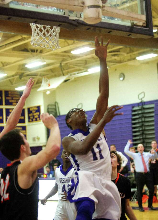 Westhill's Chianta Holtzclaw takes a shot during Friday's basketball game against Ridgefield in Stamford, Conn., on December 20, 2013. Photo: Lindsay Perry / Stamford Advocate