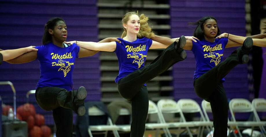 The Westhill Dance Team performs during Friday's basketball game in Stamford, Conn., on December 20, 2013. Photo: Lindsay Perry / Stamford Advocate