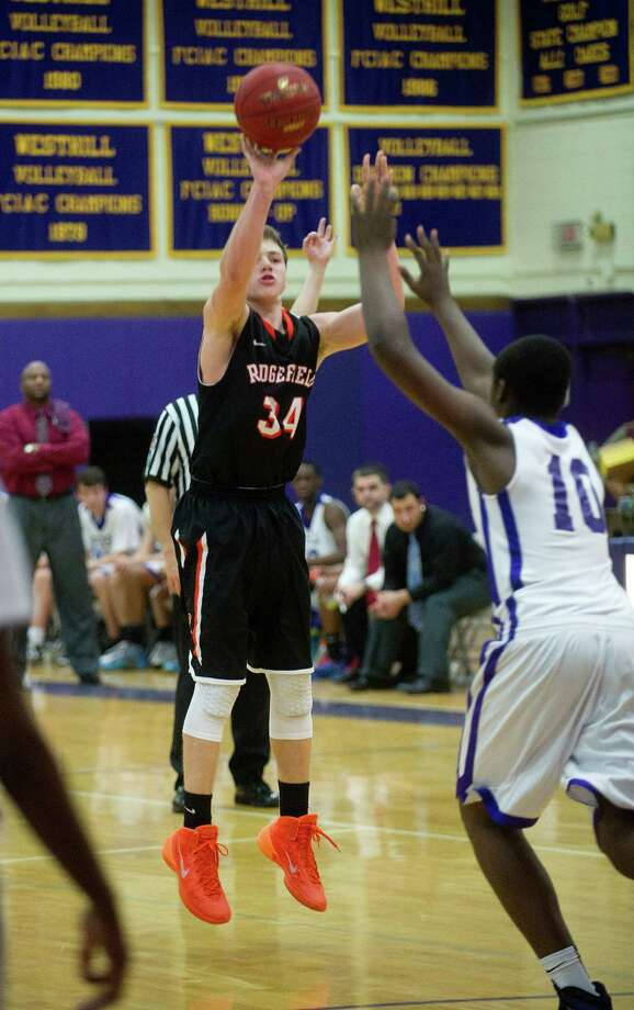 Ridgefield's Charles Irwin takes a shot during Friday's basketball game against Westhill in Stamford, Conn., on December 20, 2013. Photo: Lindsay Perry / Stamford Advocate