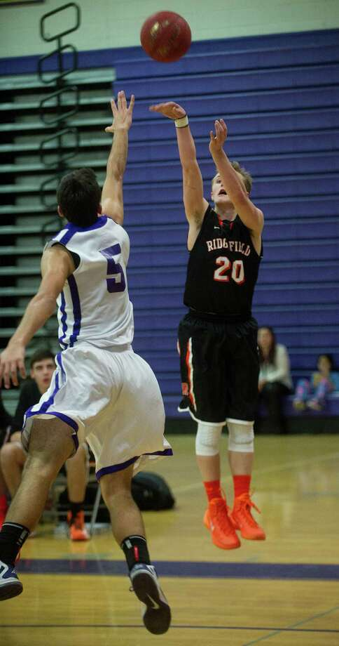 Ridgefield's Matthew Brennan takes a shot during Friday's basketball game against Westhill in Stamford, Conn., on December 20, 2013. Photo: Lindsay Perry / Stamford Advocate