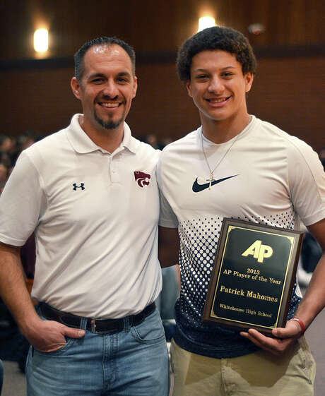 Patrick Mahomes holds his award as he poses with Whitehouse High School football coach Adam Cook in Whitehouse, Texas., Friday, Dec. 20, 2013.  The three-sport star at Whitehouse High School was named the Texas Associated Press Sports Editors football player of the year, becoming the second straight son of a former major league pitcher to win the award.  (AP Photo/Tyler Morning Helegraph, Victor Texcucano) Photo: Victor Texcucano, MBR / Tyler Morning Telegraph