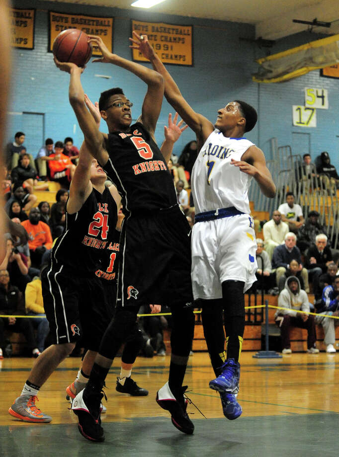 Boys basketball action between Harding and Stamford in Bridgeport, Conn. on Friday December 20, 2013. Photo: Christian Abraham / Connecticut Post