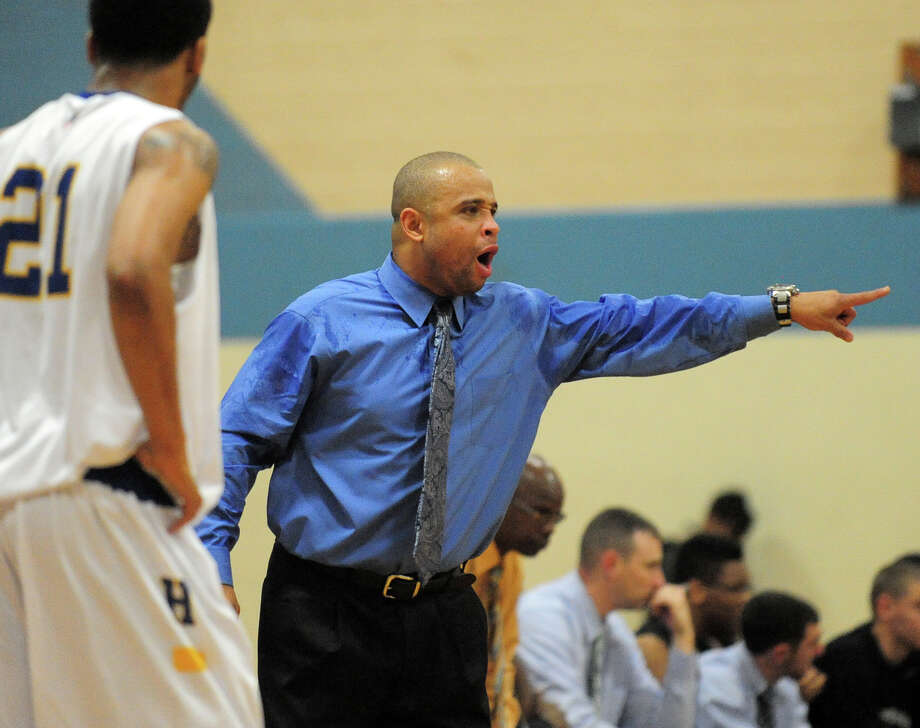 Harding Head Coach Charles Clemons, during boys basketball action against Stamford in Bridgeport, Conn. on Friday December 20, 2013. Photo: Christian Abraham / Connecticut Post