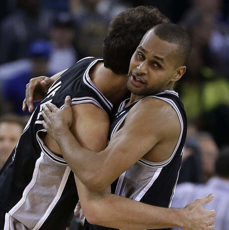 Spurs guard Patty Mills (right), Marco Belinelli and the Spurs hung on to defeat the Warriors 104-102 late Thursday night. Mills was more pleased with his defensive efforts than his season-best 20 points, especially on a pair of late plays against Stephen Curry. Photo: Ben Margot / Associated Press / AP