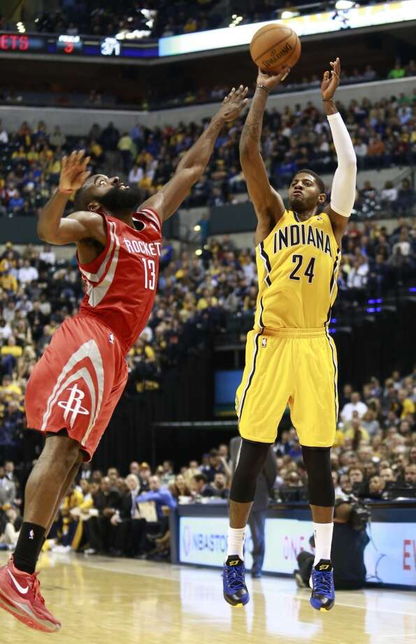 Dec. 20: Pacers 114, Rockets 81  Pacers forward Paul George (24) shoots while guarded by Rockets guard James Harden. Photo: R Brent Smith, Associated Press