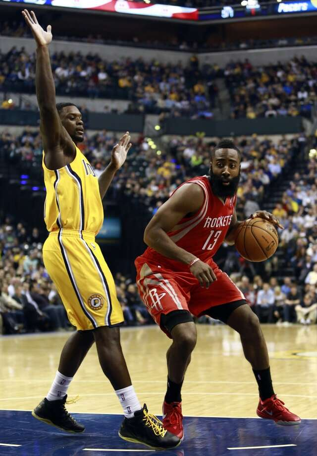 Rockets guard James Harden (13) moves by Pacers guard Lance Stephenson. Photo: R Brent Smith, Associated Press