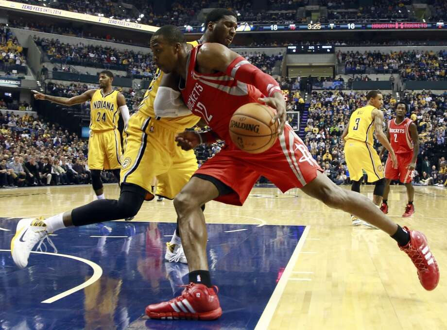 Rockets center Dwight Howard (12) pushes into Pacers center Roy Hibbert while driving to the basket. Photo: R Brent Smith, Associated Press