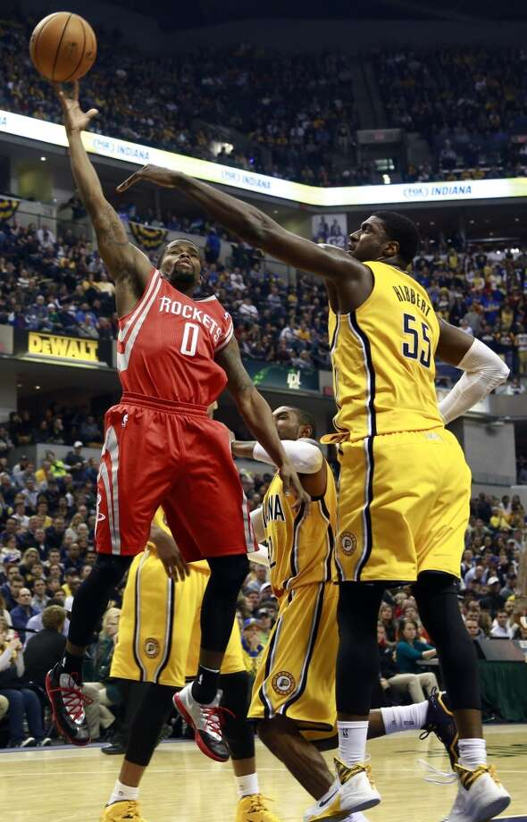 Rockets guard Aaron Brooks (0) shoots while defended by Pacers center Roy Hibbert. Photo: R Brent Smith, Associated Press