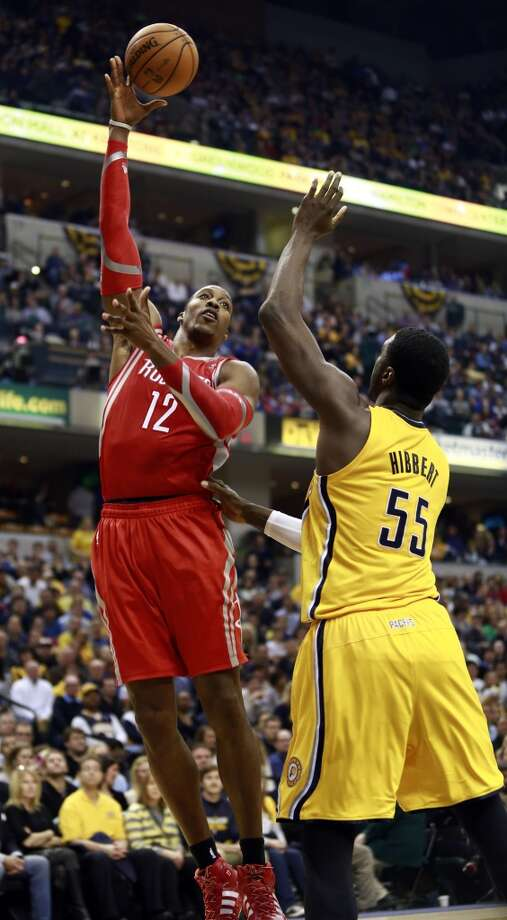 Rockets center Dwight Howard (12) shoots over Pacers center Roy Hibbert. Photo: R Brent Smith, Associated Press