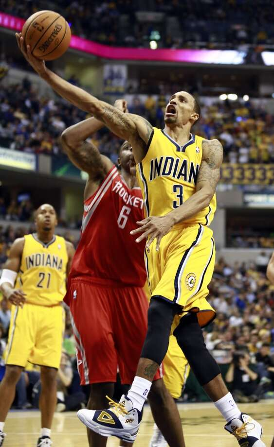 Pacers guard George Hill (3) shoots after getting past Rockets forward Terrence Jones. Photo: R Brent Smith, Associated Press