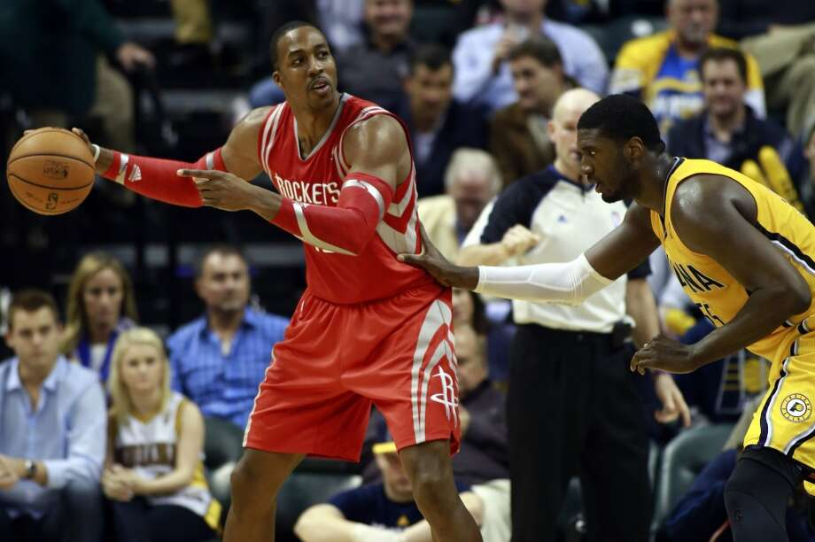 Rockets center Dwight Howard, left, controls the basketball guarded by Pacers center Roy Hibbert. Photo: R Brent Smith, Associated Press