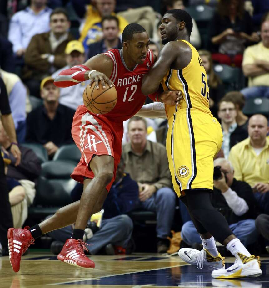 Rockets center Dwight Howard (12) moves toward the basket while guarded by Pacers center Roy Hibbert. Photo: R Brent Smith, Associated Press
