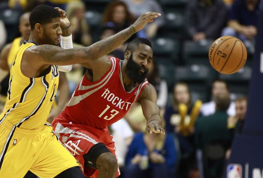 Pacers forward Paul George, left, and Rockets guard James Harden (13) chase the ball. Photo: R Brent Smith, Associated Press