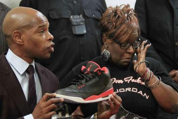 Deric Muhammad addresses the media with Dazie Williams, urging parents to accompany children when they go to purchase Air Jordans.