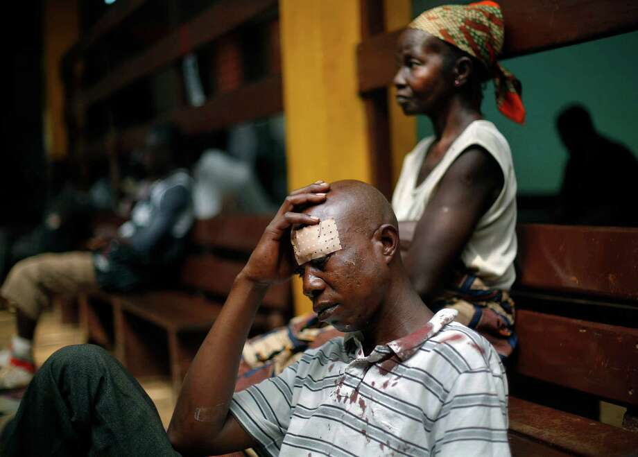 A man wounded during fighting in the Central African Republic sits on the floor at Community Hospital in Bangui. The fighting has said to have left 583 people dead since Dec. 5. Photo: Jerome Delay / Associated Press / AP