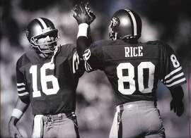 Joe Montana (16) and Jerry Rice (80) high-five after a touchdown pass on Novemeber 9, 1986.