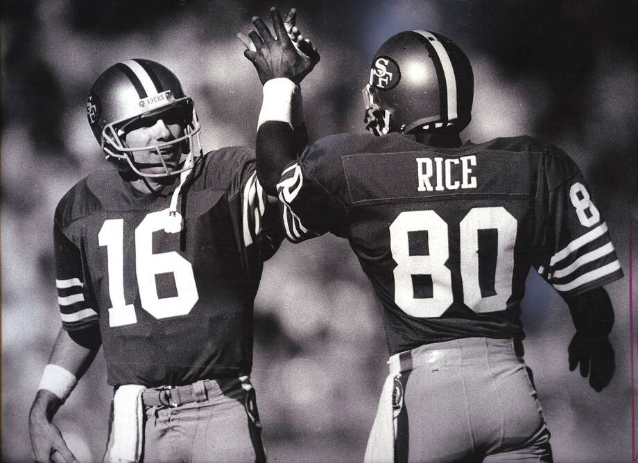 Joe Montana (16) and Jerry Rice (80) high-five after a touchdown pass on Novemeber 9, 1986. Photo: Frederick Larson/San Francisco C