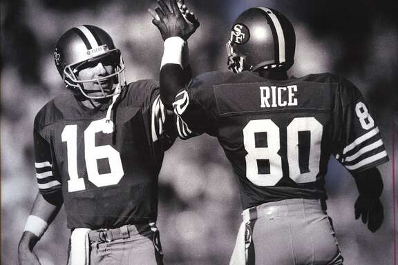 Joe Montana (16) and Jerry Rice (80) high-five after a touchdown pass on Novemeber 9, 1986.