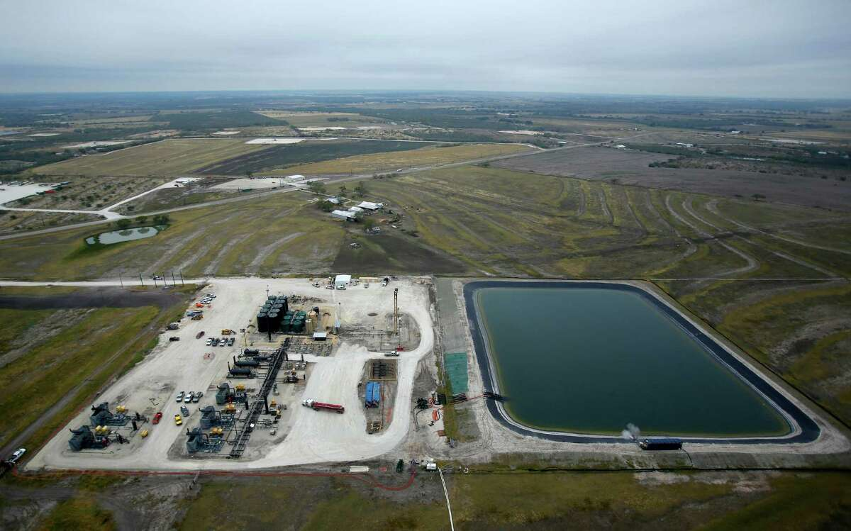 A water retention pond, right, is seen in a Dec. 13, 2013 aerial picture taken in the Eagle Ford Shale region near Karnes City.