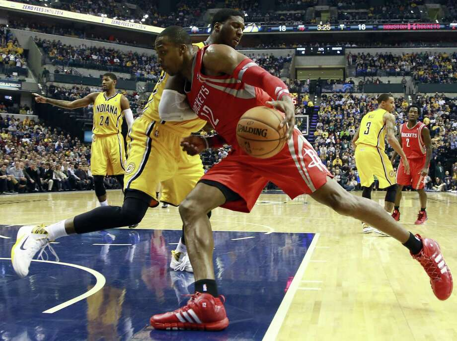 Rockets center Dwight Howard meets the resistance of Pacers big man Roy Hibbert during Indiana's win. Photo: R Brent Smith / Associated Press / FR171017 AP